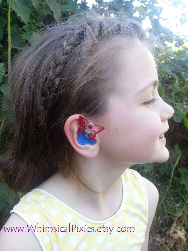 Whimsical wings for hearing aids