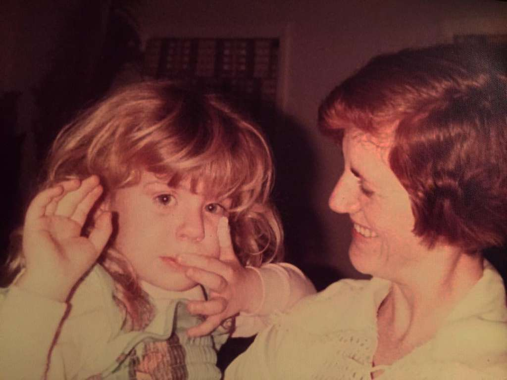 My mother and I when I was young. I had probably worn hearing aids for 1-2 years at this point, and this long, thick hair would cover them until my teens.