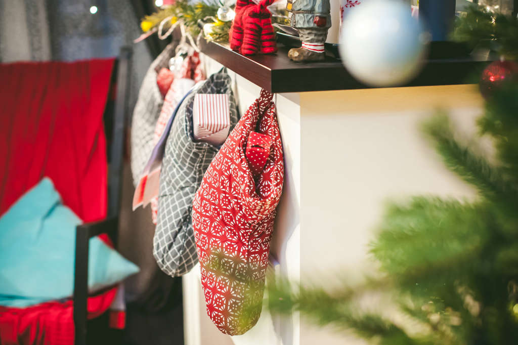 Christmas socks with gifts on the fireplace. Christmas warm cozy interior room in anticipation of the holiday